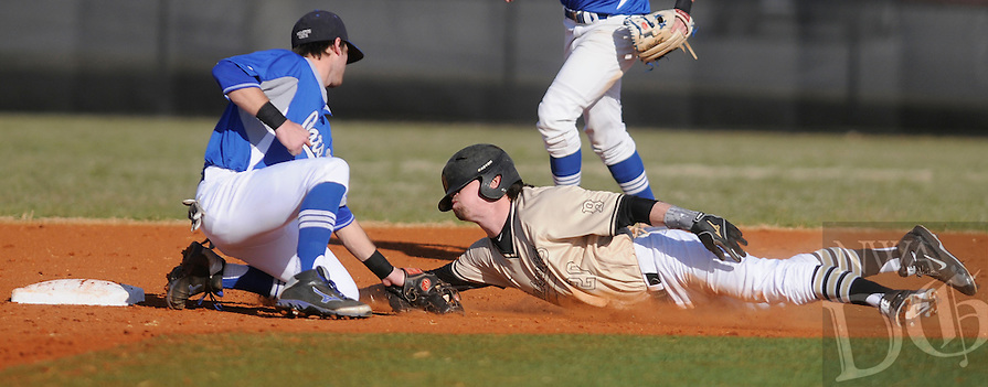 NWA Democrat-Gazette/ J.T. WAMPLER --Bentonville's Cody Scroggins gets caught at second by Conway's Jacob Adams Wednesday March 11, 2015 during the Best Sports Invitational at Bentonville.