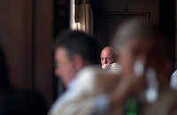 The face of a local man hints at the ghost of noted Argentine author Jorge Luis Borges as he sips coffee at the Cafe Petit Colon in Buenos Aires. Borges, a magic realist author, influenced the work of many of the western hemisphere's greatest writers.<br /><br />(Kevin Moloney for the New York Times)