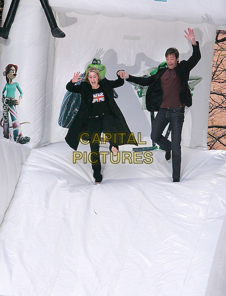 "KATE WINSLET & HUGH JACKMAN.""Flushed Away"" New York Premiere held at AMC Lincoln Square, New York, New York, USA..October 24th, 2006.Ref: ADM/JL.full length union jack flack top coat jacket funny jumping gesture sliding slide holding hands.www.capitalpictures.com.sales@capitalpictures.com.©Jackson Lee/AdMedia/Capital Pictures."