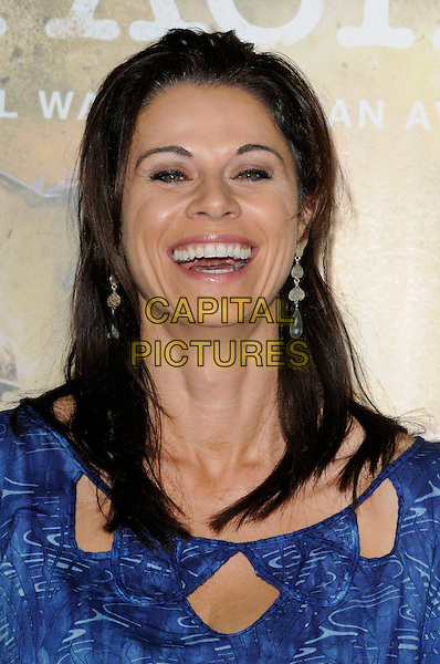 "JENNIFER TAYLOR.The Los Angeles premiere of HBO's new miniseries event ""The Pacific"" at Grauman's Chinese Theatre in Hollywood, California.  .February 24th, 2010.headshot portrait smiling mouth open laughing top  blue cut out print.CAP/ROT.©Lee Roth/Capital Pictures"