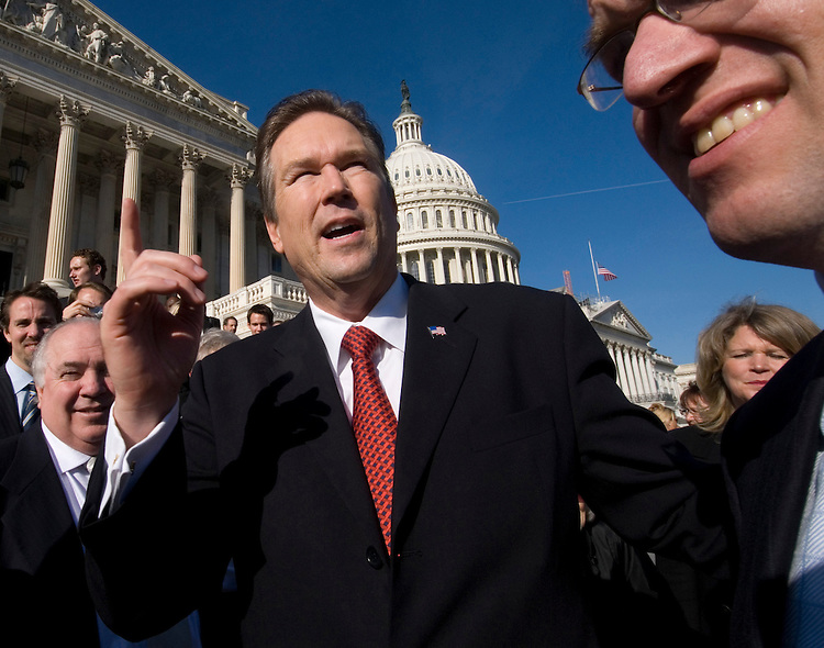 Rep. Vern Buchanan, R-Fla., meets family and friends for a group photo on the steps of the Capitol on Thursday, Jan. 4, 2007.