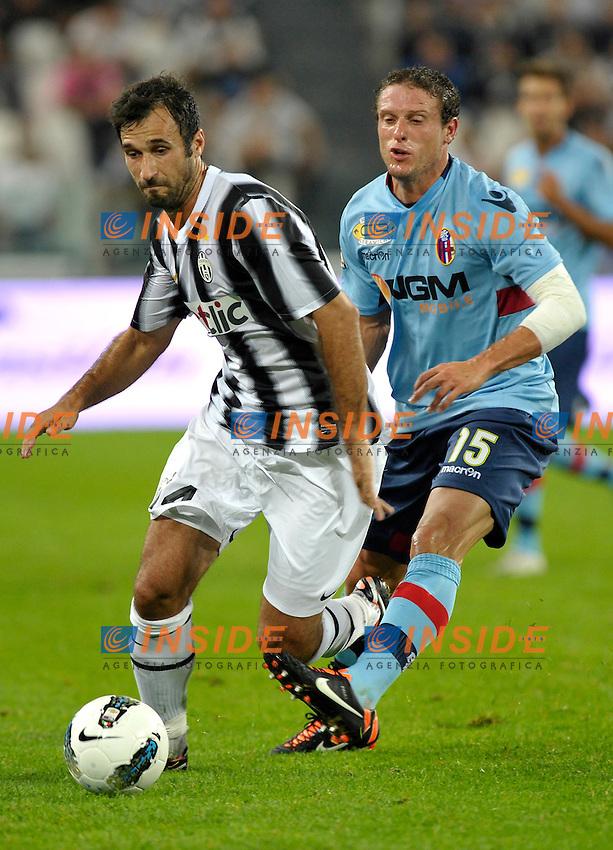 Mirko Vucinic (Juventus) e Diego Perez (Bologna).Torino 21/09/2011 Juventus Stadium.Serie A 2011/2012 .Football Calcio Juventus Bologna 1-1.Foto Insidefoto Giorgio Perottino
