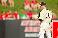 Wake Forest Demon Deacons relief pitcher Jack Fischer #15 looks to his catcher for the sign against the North Carolina State Wolfpack at Doak Field at Dail Park on March 17, 2012 in Raleigh, North Carolina.  The Wolfpack defeated the Demon Deacons 6-2.  (Brian Westerholt/Four Seam Images)