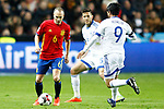 Spain's Andres Iniesta (l) and Israel's Rami Gershon (c) and Lior Refaelov during FIFA World Cup 2018 Qualifying Round match. March 24,2017.(ALTERPHOTOS/Acero)