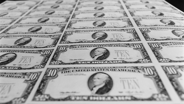 $10 bills pre-serial numbered at Bureau of Engraving and Printing. (Photo by Maureen Keating/CQ Roll Call via Getty Images)