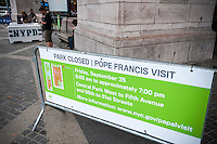 An informational sign outside of Central Park on Tuesday, September 22, 2015 informs visitors of the park's closure for Pope Francis' visit. While in New York the Holy Father will have a motorcade in Central Park where 80,000 people who received tickets will see him.  (© Richard B. Levine)