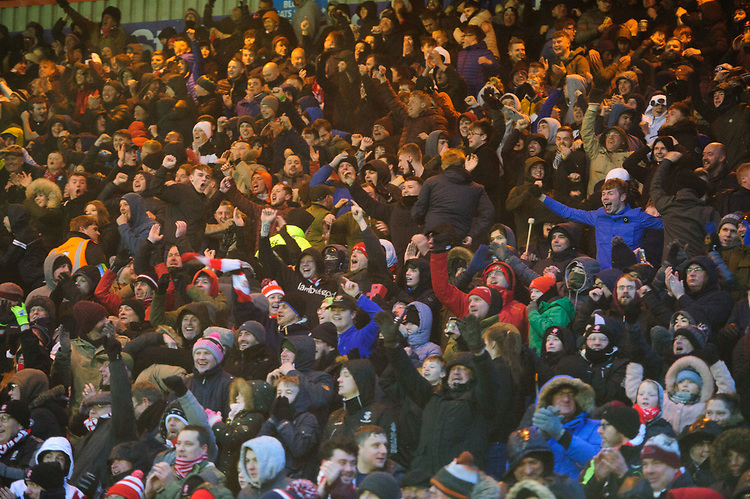 Lincoln City fans celebrate their teams goal, scored by Jason Shackell<br /> <br /> Photographer Chris Vaughan/CameraSport<br /> <br /> The EFL Sky Bet League Two - Saturday 15th December 2018 - Lincoln City v Morecambe - Sincil Bank - Lincoln<br /> <br /> World Copyright © 2018 CameraSport. All rights reserved. 43 Linden Ave. Countesthorpe. Leicester. England. LE8 5PG - Tel: +44 (0) 116 277 4147 - admin@camerasport.com - www.camerasport.com