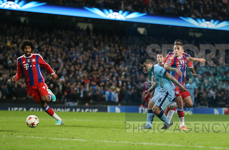 Sergio Aguero of Manchester City scores the third goal - UEFA Champions League group E - Manchester City vs Bayern Munich - Etihad Stadium - Manchester - England - 25rd November 2014  - Picture Simon Bellis/Sportimage