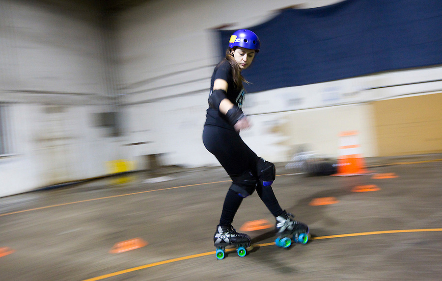 Lucky Punk, of the Storm City Roller Girls practices skating backwards in Vancouver Thursday February 9, 2017. (Photo by Natalie Behring for the Columbian)