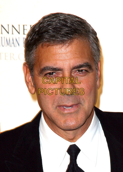 GEORGE CLOONEY .The Robert F. Kennedy Center for Justice & Human Rights Ripple of Hope awards dinner at Chelsea Piers, New York City, NY, USA, .17th November 2010..portrait headshot smiling black tie mouth open   .CAP/ADM/PZ.©Paul Zimmerman/AdMedia/Capital Pictures.
