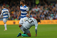 Nahki Wells of Queens Park Rangers  helps up Bradley Dack of Blackburn Rovers during Queens Park Rangers vs Blackburn Rovers, Sky Bet EFL Championship Football at Loftus Road Stadium on 5th October 2019