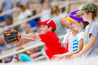 A young fan tries to get a baseball from one of the players during the South Atlantic League game between the West Virginia Power and the Kannapolis Intimidators at Fieldcrest Cannon Stadium on April 20, 2011 in Kannapolis, North Carolina.   Photo by Brian Westerholt / Four Seam Images