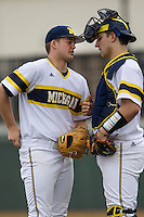 Michigan Wolverines pitcher Brett Adcock (35) talks with catcher Harrison Wenson (45) during the NCAA baseball game against the Washington Huskies on February 16, 2014 at Bobcat Ballpark in San Marcos, Texas. The game went eight innings, before travel curfew ended the contest in a 7-7 tie. (Andrew Woolley/Four Seam Images)