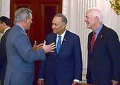United States House Majority Leader Kevin McCarthy (Republican of California), left, engages in conversation with US Senate Minority Leader Chuck Schumer (Democrat of New York), center, as US Senate Majority Whip John Cornyn (Republican of Texas), right, looks on prior to the arrival of President Donald Trump at a reception for US House and US Senate Republican and Democratic leaders in the State Dining Room of the White House in Washington, DC on Monday, January 23, 2017.<br /> Credit: Ron Sachs / Pool via CNP