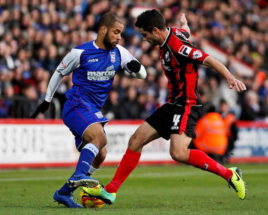Ipswich Town's David McGoldrick takes the ball around Bournemouth's Andrew Surman.<br /> <br /> Photo by James Marsh/CameraSport<br /> <br /> Football - The Football League Sky Bet Championship - AFC Bournemouth v Ipswich Town - Sunday 29th December 2013 - Goldsands Stadium - Bournemouth<br /> <br /> &copy; CameraSport - 43 Linden Ave. Countesthorpe. Leicester. England. LE8 5PG - Tel: +44 (0) 116 277 4147 - admin@camerasport.com - www.camerasport.com
