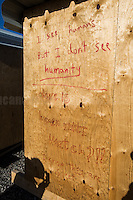 """""""Hope"""" home.<br /> <br /> Dunkirk Camp.<br /> <br /> Under the Sky of Calais & Dunkirk. Two Camps, Two Sides of the Same Coin: Not 'migrants', Not 'refugees', just Humans.<br /> <br /> France, 24-30/03/2016. Documenting (and following) Zekra and her experience in the two French camps at the gate of the United Kingdom: Calais' """"Jungle"""" and Dunkirk's """"Grande-Synthe"""". Zekra lives in London but she is originally from Basra in Iraq. Zekra and her family had to flee Kuwait - where they moved for working reason - due to the """"Gulf War"""", and to the Western Countries' will to """"export Democracy in Iraq"""". Zekra is a self-motivated volunteer and founder of """"Happy Ravers"""", a group of people (not a NGO or a charity) linked to each other because of their love for rave parties but also men and women who meet up every week to help homeless people and other people in need in Central London. (Here there are some of the stories I covered about Zekra and """"Happy Ravers"""": http://bit.ly/1XVj1Cg & http://bit.ly/24kcGQz & http://bit.ly/1TY0dPO). Zekra worked as an English teacher in the adult school at Dunkirk's """"Grande-Synthe"""" camp and as a cultural mediator and Arabic translator for two medic teams in Calais' """"Jungle"""". Please read her story at the beginning of this reportage."""