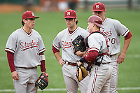 Jake Shandler, Jordan Pries, Jonathan Kaskow and catcher Zach Jones of the Stanford Cardinal meet against the Texas Longhorns at  UFCU Disch-Falk Field in Austin, Texas on Friday February 26th, 2100.  (Photo by Andrew Woolley / Four Seam Images)