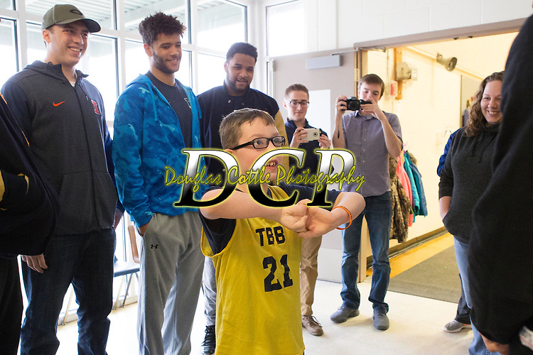 February 10, 2018- Tuscola, IL- Tuscola's Colton Rahn meets members of the Illini Football team prior to his biddy basketball game. The Illini Football team surprised Rahn, a big Illini fan who has cerebral palsy, as they came to watch him play basketball. [Photo: Douglas Cottle]