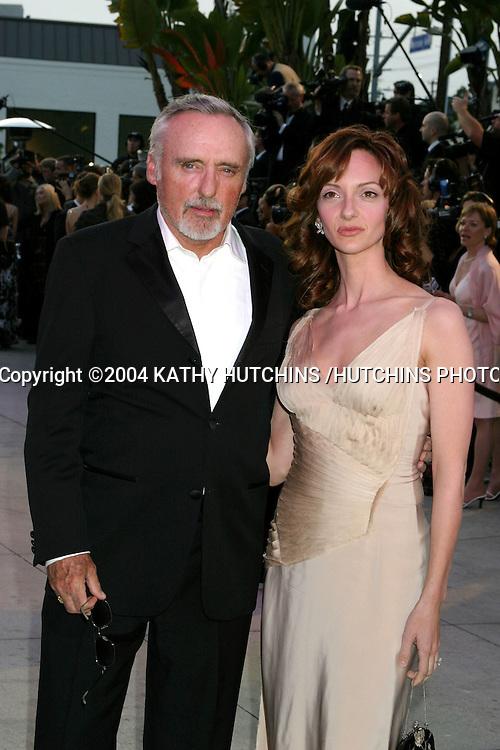 ©2004 KATHY HUTCHINS /HUTCHINS PHOTO.VANITY FAIR OSCAR PARTY.MORTONS RESTAURANT.WEST HOLLYWOOD, CA .FEBRUARY 29, 2004..DENNIS HOPPER AND VICTORIA