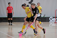 Malaysia's Ivana Sonia Anak Beriak and New Zealand's Nia Emrys in action during the World Floorball Championships 2017 Qualification for Asia Oceania Region - New Zealand v Malaysia at ASB Sports Centre , Wellington, New Zealand on Saturday 4 February 2017.<br /> Photo by Masanori Udagawa<br /> www.photowellington.photoshelter.com.