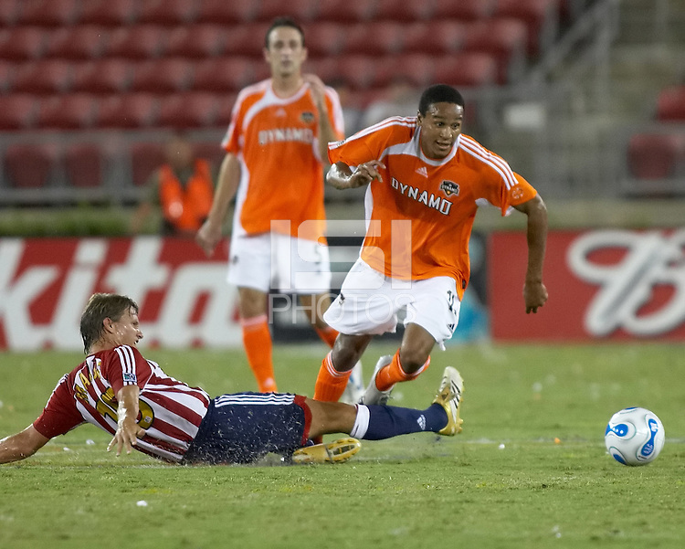 Chivas USA midfielder Jesse Marsch slide tackles Houston Dynamo midfielder Ricardo Clark.  Houston Dynamo and Chivas USA drew to a 0-0 tie at Robertson Stadium in Houston, TX on September 17, 2006.