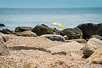 Hammonasset Beach State Park, Madison, CT. Reading among the rocky shoreline. Meigs Point