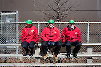 Shriners sit on a railing before the start of the parade to march in the 2013 annual St. Patrick's Day Parade in South Boston, Boston, Massachusetts, USA.