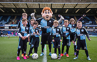 Match day Mascots pose with Bodger the Wycombe Mascot during the Sky Bet League 2 match between Wycombe Wanderers and Portsmouth at Adams Park, High Wycombe, England on 28 November 2015. Photo by Andy Rowland.