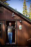 Ron Grassi poses for a portrait in his Tahoe City, Calif. home May 13, 2010. Grassi is suing the big three ratings agencies after he lost $40,000 on a Lehman Brothers bond.