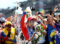 May 28, 2017; Indianapolis, IN, USA; IndyCar Series driver Takuma Sato dumps milk on himself as he celebrates after winning the 101st Running of the Indianapolis 500 at Indianapolis Motor Speedway. Mandatory Credit: Mark J. Rebilas-USA TODAY Sports