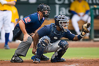 Catcher Angel Salome (26) of the Huntsville Stars and home plate umpire  Quinn Wolcott at the Baseball Grounds in Jacksonville, FL, Wednesday June 11, 2008.