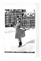 Female ice skater displaying winter sports, on the ice rink of the Chateau Frontenac, photograph, 1959, from the Archives of the Chateau Frontenac, Quebec City, Quebec, Canada. The Chateau Frontenac opened in 1893 and was designed by Bruce Price as a chateau style hotel for the Canadian Pacific Railway company or CPR. It was extended in 1924 by William Sutherland Maxwell. The building is now a hotel, the Fairmont Le Chateau Frontenac, and is listed as a National Historic Site of Canada. The Historic District of Old Quebec is listed as a UNESCO World Heritage Site. Copyright Archives Chateau Frontenac / Manuel Cohen
