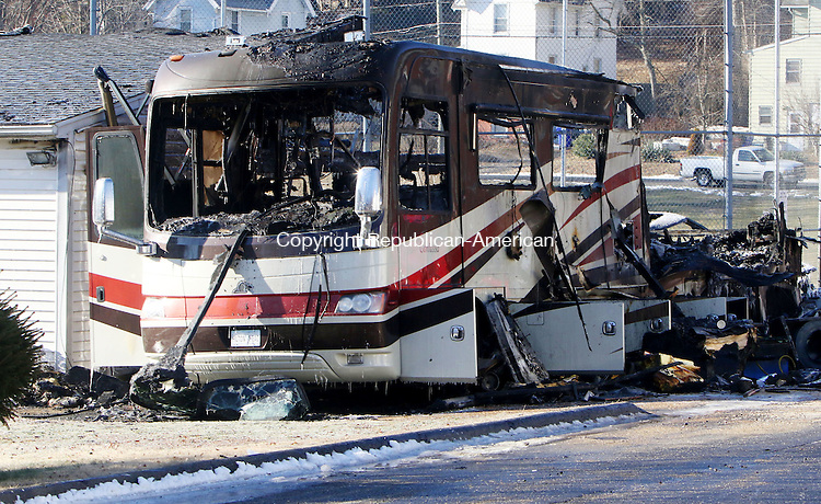 THOMASTON CT. 06 January 2015-010616SV01-Fire ripped through an RV and a 2 car garage on High Street in Thomaston early Wednesday. A few area town responded to help firefighters.<br /> Steven Valenti Republican-American