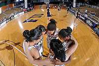 25 February 2012:  FIU's starters (guard Fanni Hutlassa (10), guard Sasha Melnikova (5), guard-forward Finda Mansare (23), guard Jerica Coley (22) and guard Carmen Miloglav (24)) huddle prior to the start of the game.  The FIU Golden Panthers defeated the University of South Alabama Jaguars, 58-55 (OT), at the U.S. Century Bank Arena in Miami, Florida.