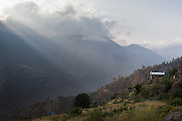 The sun shines through the clouds in Briddhim. Tamang Heritage Trail, Nepal, 07 May 2013.