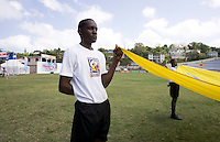 A young volunteer carries the FIFA Fair Play flag onto the field during the group stage of the CONCACAF Men's Under 17 Championship at Jarrett Park in Montego Bay, Jamaica. Costa Rica defeated El Salvador, 3-2.