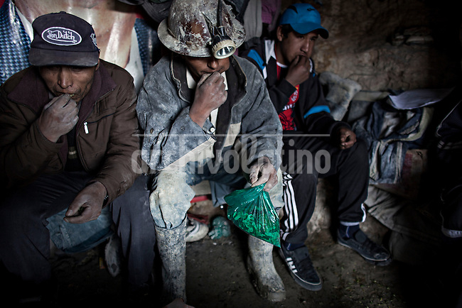 A picture dated Friday January 25, 2013 shows a group of miners chewing coca leaves before the Miners Carnival in the Andes city of Potosi in Bolivia.  Already in 1663 the Spanish chronicler Marquez Jerez de los Caballeros described the colorful  miners carnival in Potosi. Four centuries later, the tradition of the legendary Cerro Rico miners is  still alive ..