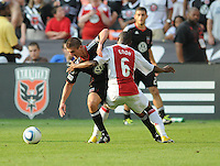 DC United midfielder Perry Kitchen (23) gets fouled  by AFC Ajax midfielder Eyong Enoh (6)   AFC Ajax defeated DC United 2-1 during an International Friendly at RFK Stadium Sunday May 22, 2011.