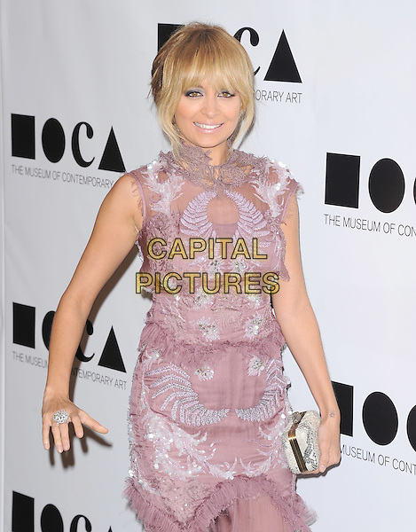 """Nicole Richie .at The 2011 MOCA Gala """"An Artist's Life Manifesto"""" With Artistic Direction From Marina Abramovic held at MOCA Grand Avenue in Los Angeles, California, USA, .November 13th 2011..half length purple grey gray sheer silver sleeveless clutch bag beaded pink lilac .CAP/RKE/DVS.©DVS/RockinExposures/Capital Pictures."""