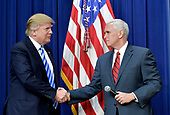 United States Vice President Mike Pence introduces US President Donald Trump at a CEO town hall on the American business climate in the South Court Auditorium of the White House in Washington, DC, April 4, 2017.<br /> Credit: Olivier Douliery / Pool via CNP
