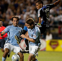 Ryan Johnson tires to kick the ball above Nick LaBrocca (left) and Drew Moor (3). San Jose Earthquakes tied the Colorado Rapids 1-1 at Buck Shaw Stadium in Santa Clara, California on September 18, 2009.