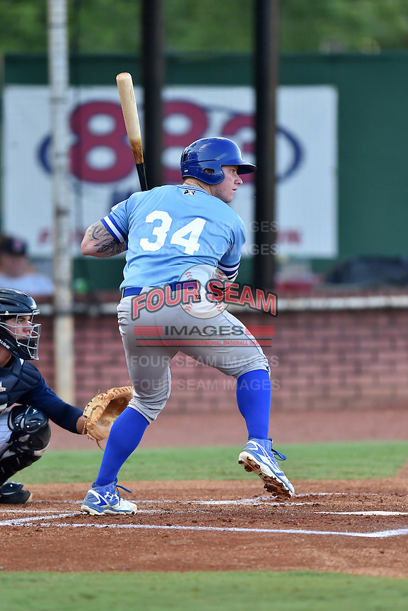 Burlington Royals first baseman Chris Devito (34) swings at a pitch during game against the Elizabethton Twins at Joe O'Brien Field on August 24, 2016 in Elizabethton, Tennessee. The Royals defeated the Twins 8-3. (Tony Farlow/Four Seam Images)