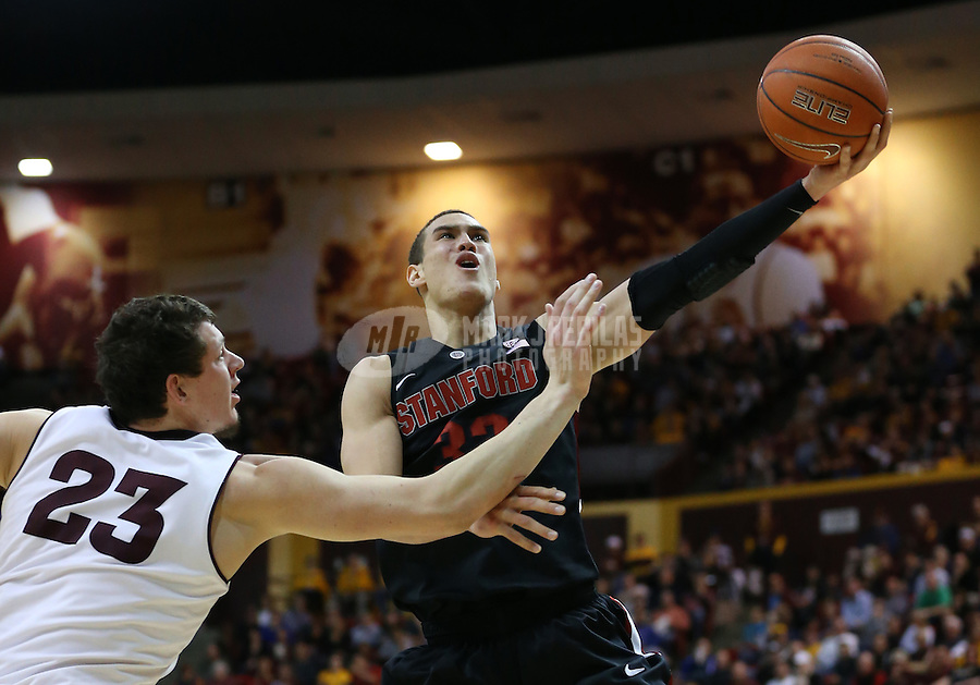 Feb. 9, 2013; Tempe, AZ, USA: Stanford Cardinal forward Dwight Powell (33) drives to the basket against Arizona State Sun Devils center Ruslan Pateev (23) in the second half at the Wells Fargo Arena. Stanford defeated Arizona State 62-59. Mandatory Credit: Mark J. Rebilas-