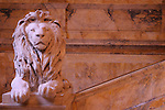 Stone lion on the staircase in the Public Library in Boston, MA.