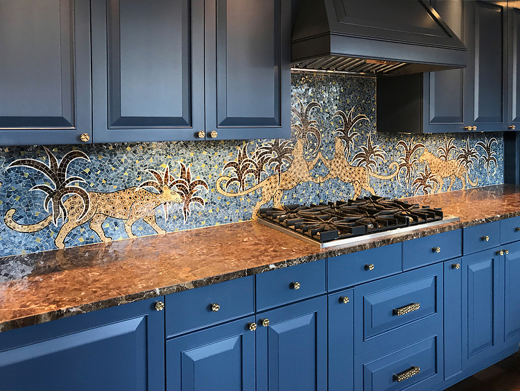 Leopard, a hand-nipped jewel glass mosaic, was designed by Lotty Bunbury for New Ravenna.<br /> <br /> -Photo and kitchen design courtesy of Duncan Hughes Interiors duncanhughes.com
