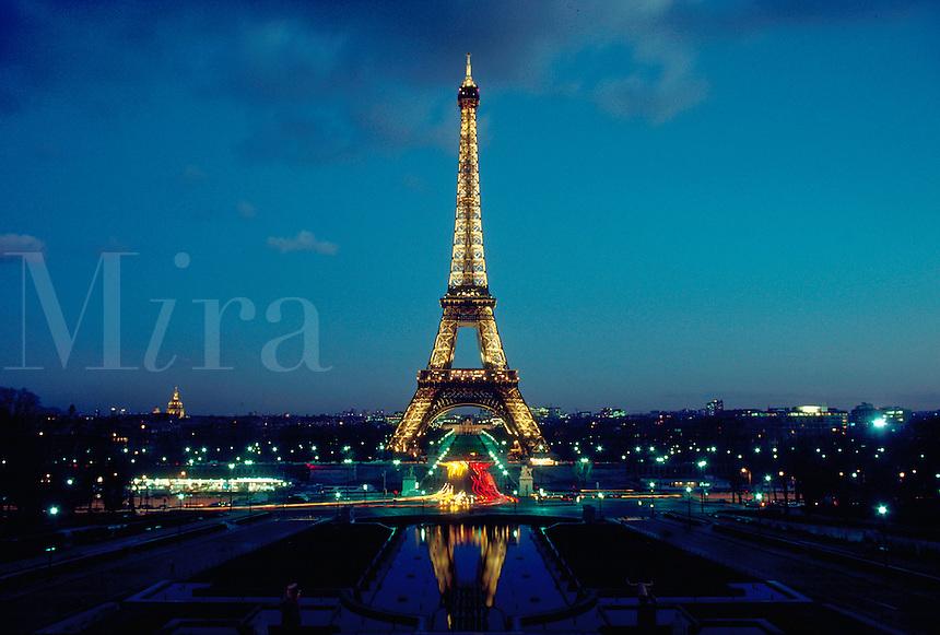 Eiffel Tower lit against night sky, Paris, France