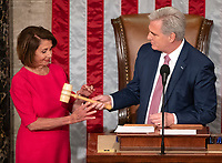 United States House Minority Leader Kevin McCarthy (Republican of California), right, hands the gavel to Speaker of the United States House of Representatives Nancy Pelosi (Democrat of California), left, as the 116th Congress convenes for its opening session in theUS House Chamber of the US Capitol in Washington, DC on Thursday, January 3, 2019. Photo Credit: Ron Sachs/CNP/AdMedia