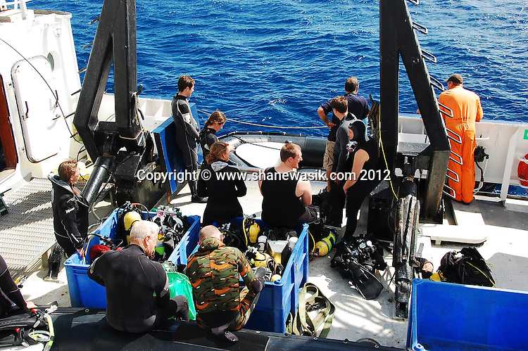 During an expedition the diver prepare equipment for loading into the Zodiac dive boats.