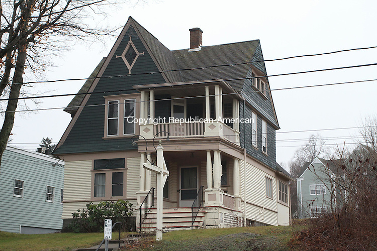 WATERTOWN, CT, 22 December, 2015 - 122215LW01 - This Victorian home at 666 Main St. in Watertown may soon become a parking lot for patrons of the green professional and retail building next door.<br />