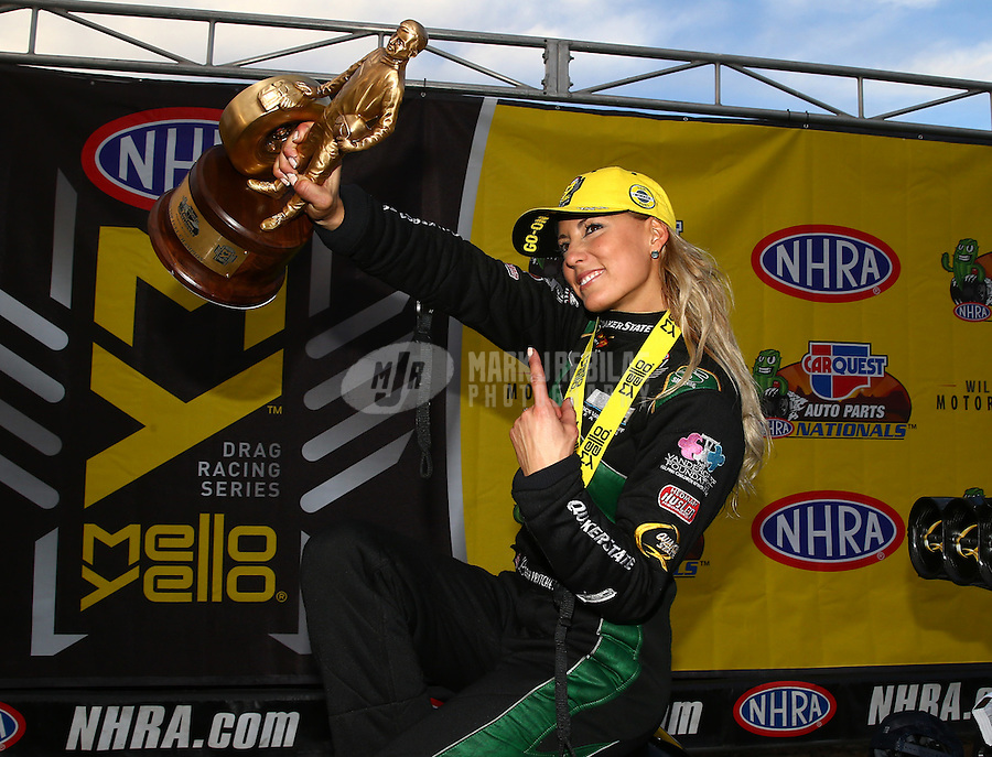 Feb 28, 2016; Chandler, AZ, USA; NHRA top fuel driver Leah Pritchett celebrates after winning the Carquest Nationals at Wild Horse Pass Motorsports Park. Mandatory Credit: Mark J. Rebilas-